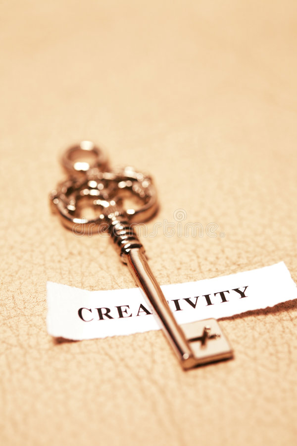 Golden key for creativity royalty free stock photography