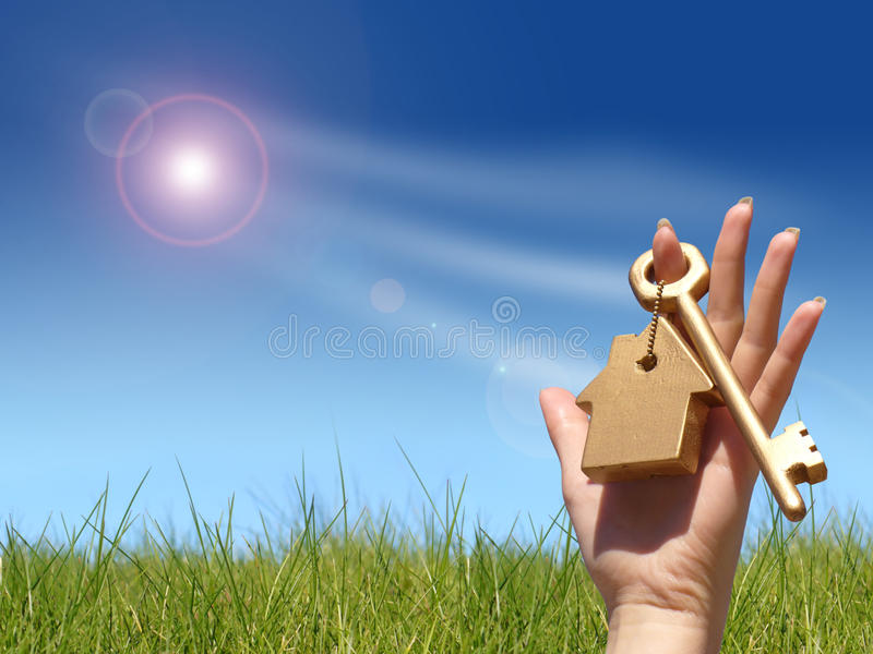 Golden key in hand. New house owner concept stock photography