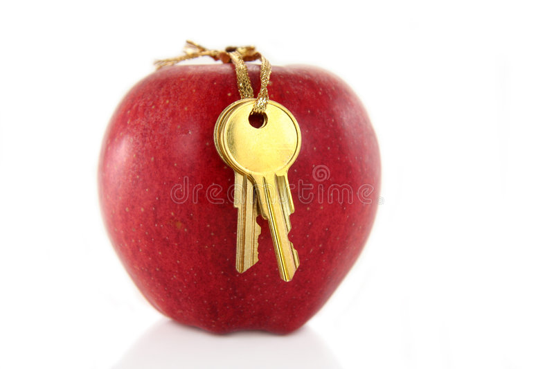 Golden key and red apple royalty free stock images