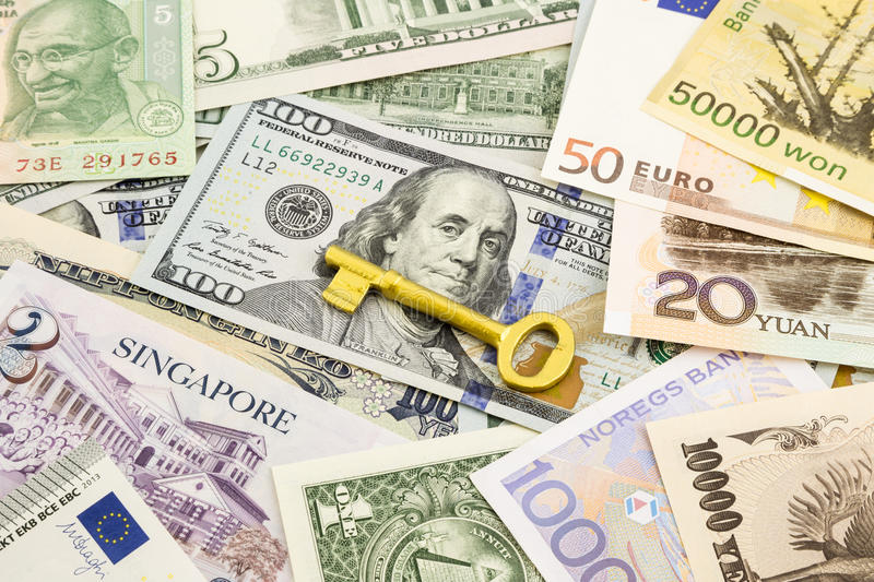 Golden key and world currency money banknotes royalty free stock photos