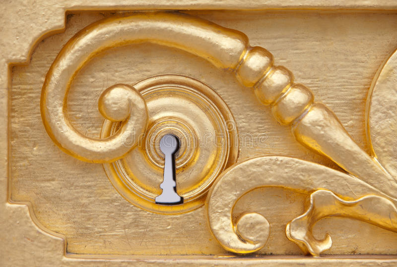 Golden keyhole royalty free stock images