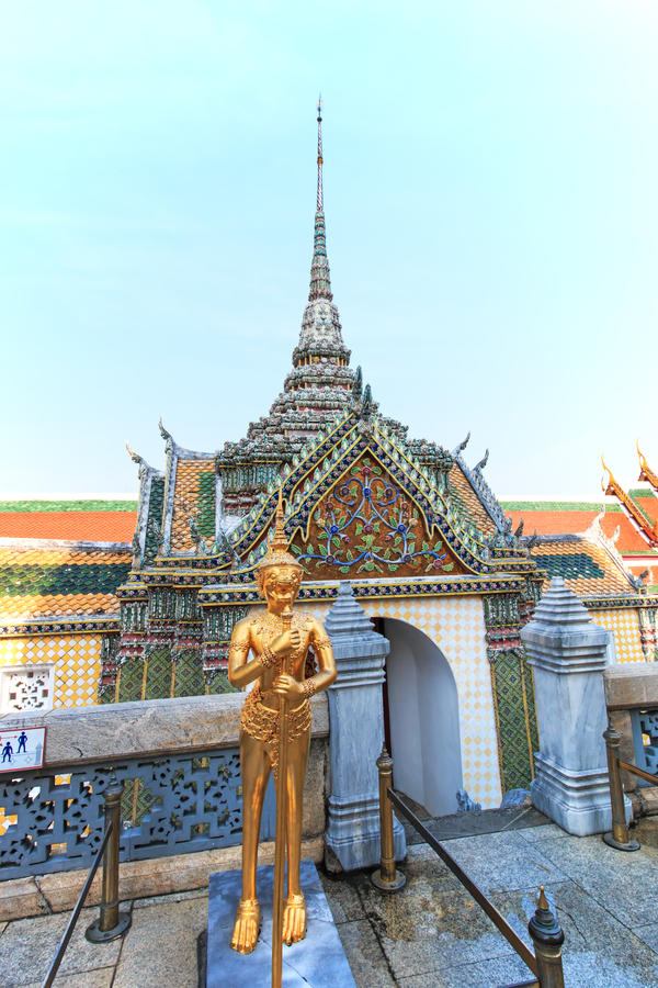 A Golden Kinnari statue att he Temple of the Emerald Buddha (Wat Phra Kaew) , Bangkok, Thailand royalty free stock images