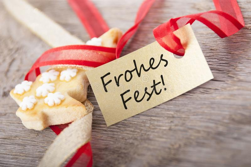 Golden label with Frohes Fest. A golden label with the german words Frohes Fest which means merry christmas as background royalty free stock image