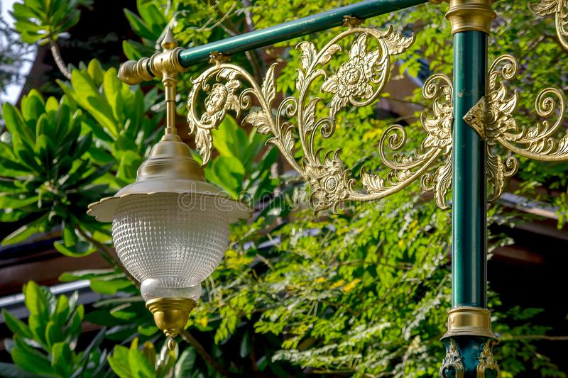 Golden lamp with Thai pattern royalty free stock images