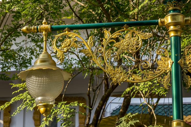 Golden lamp with Thai pattern stock photos