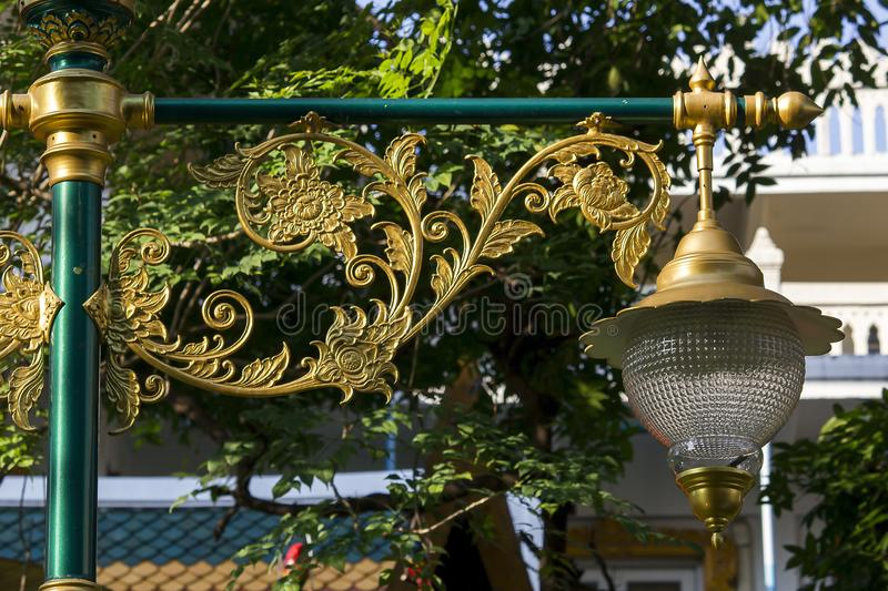 Golden lamp with Thai pattern stock photo