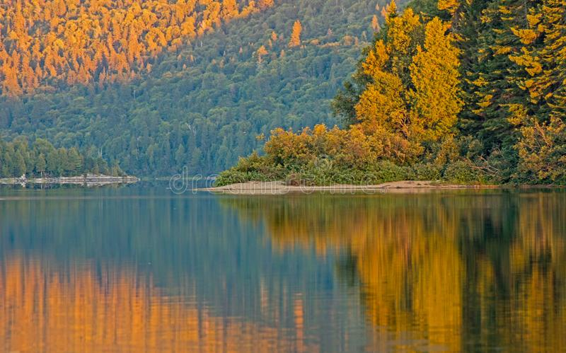 Golden Light On Big Nictau Lake. Looking across Big Nictau Lake at Mount Sagamook in Mount Carleton Provincial Park. The location is in the wilderness of north stock photos