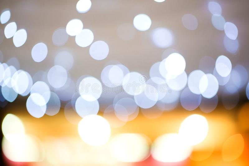 Golden light bokeh. image created by soft and blur style for background,. Wallpaper and backdrop stock images