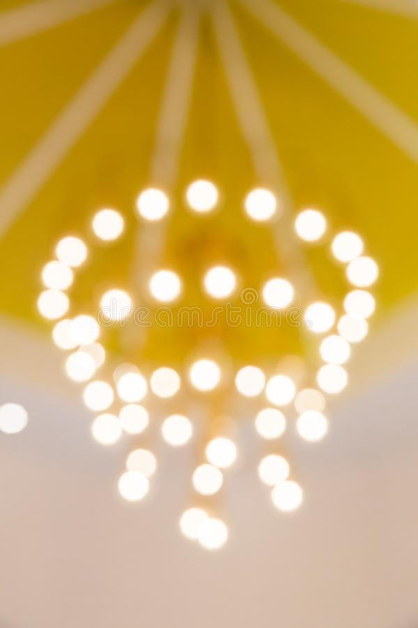 Golden light bokeh. image created by soft and blur style for background, wallpaper and backdrop. stock image