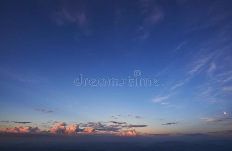 Golden light shining through the clouds in a colorful evening royalty free stock photos
