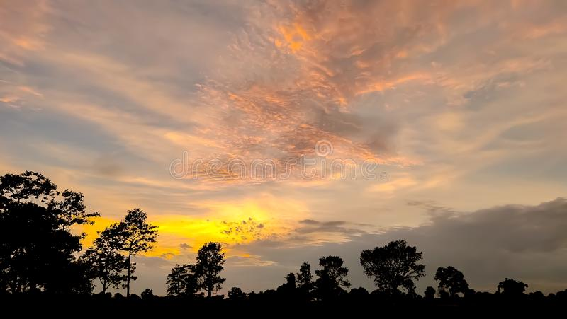 The golden light of the sun Shining through the white clouds royalty free stock photo