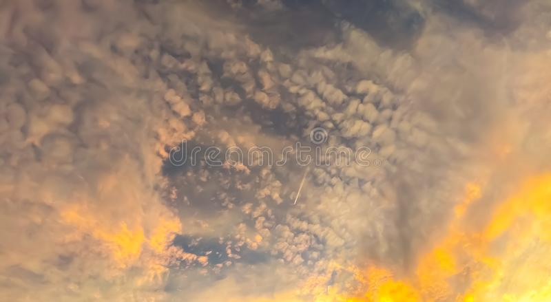Golden sunshining through white clouds royalty free stock images