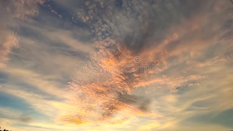 Golden sunshining through white clouds stock images