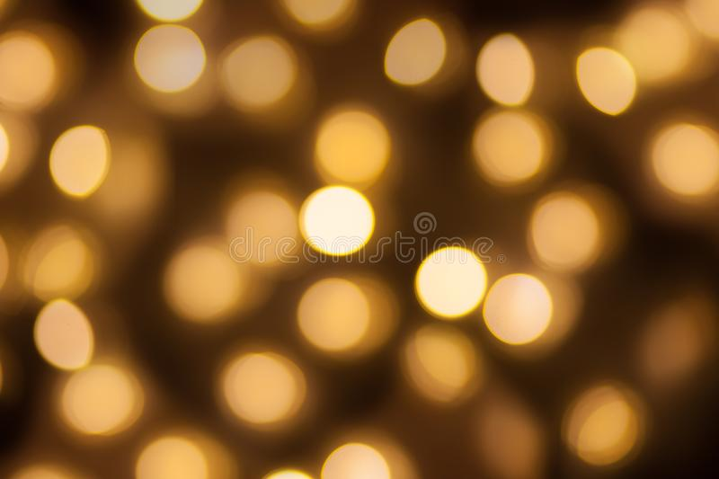 Golden lights bokeh blurred background, abstract beautiful blurry silver Christmas holiday party texture, copy space royalty free stock photos