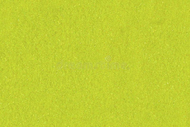 Golden Lime textured glitter background. Neon yellow shiny sparkly backdrop.  stock photos