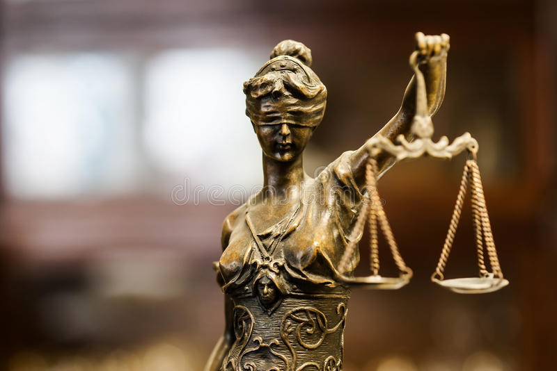 Golden look bronze statue of justice royalty free stock photos
