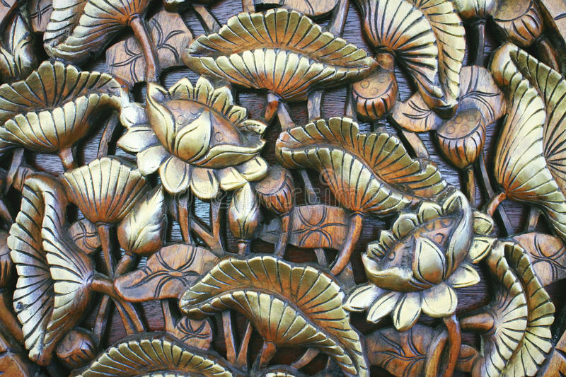 Golden lotus from wood carving stock photos