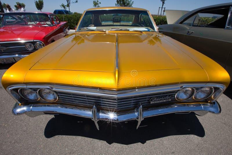 Golden Lowrider Impala Classic Car stock photos