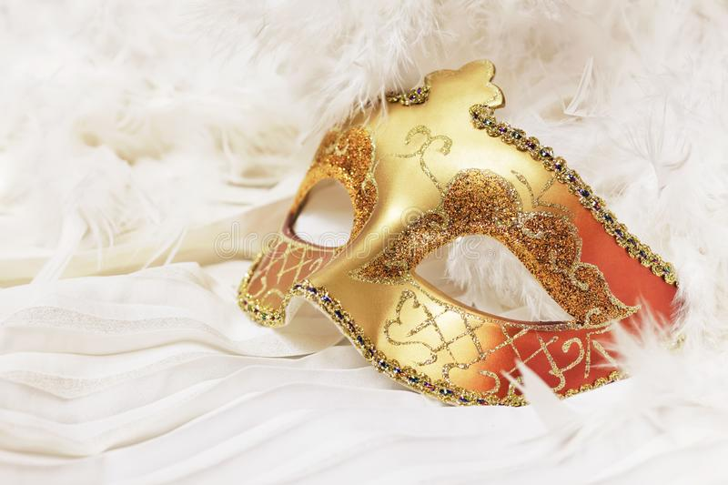 Golden Mardi Gras or Carnival mask on a white background. royalty free stock photography