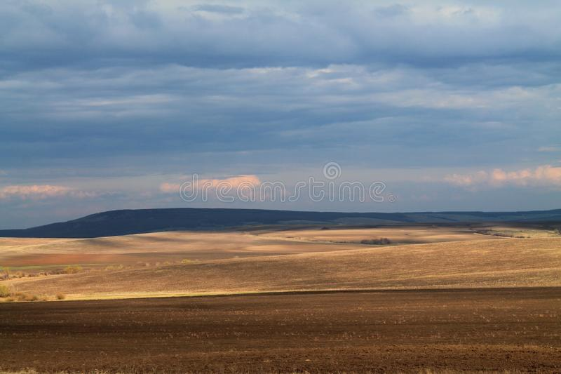 Golden meadows of Russia. Sky valley meadows fields impassability overcast nature sky hills spring royalty free stock images