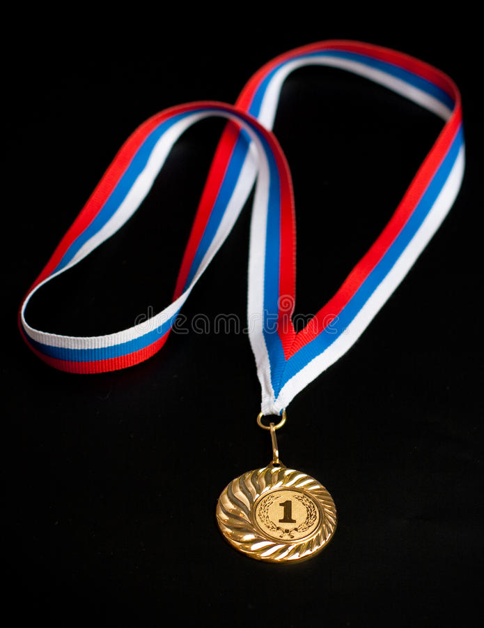 Golden Medal Isolated On Black Royalty Free Stock Photography