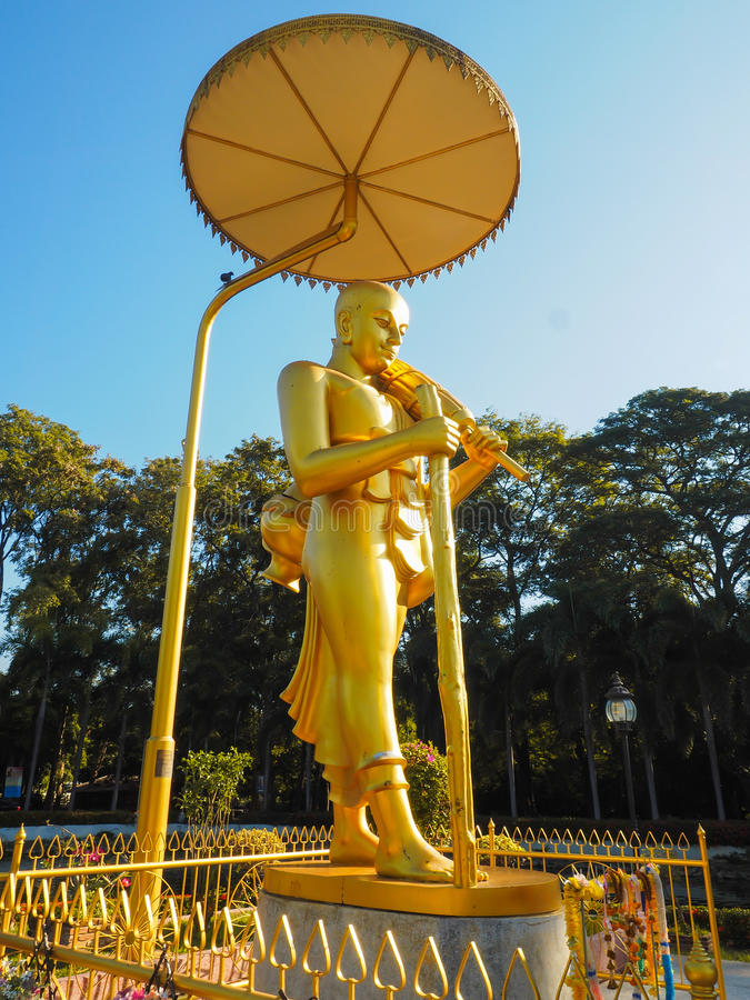 Golden meditating buddha stock photos