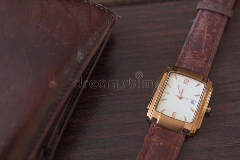 Golden Men`s Wristwatch and Wallet. Classic Wristwatch for Man with Brown Strap royalty free stock photos