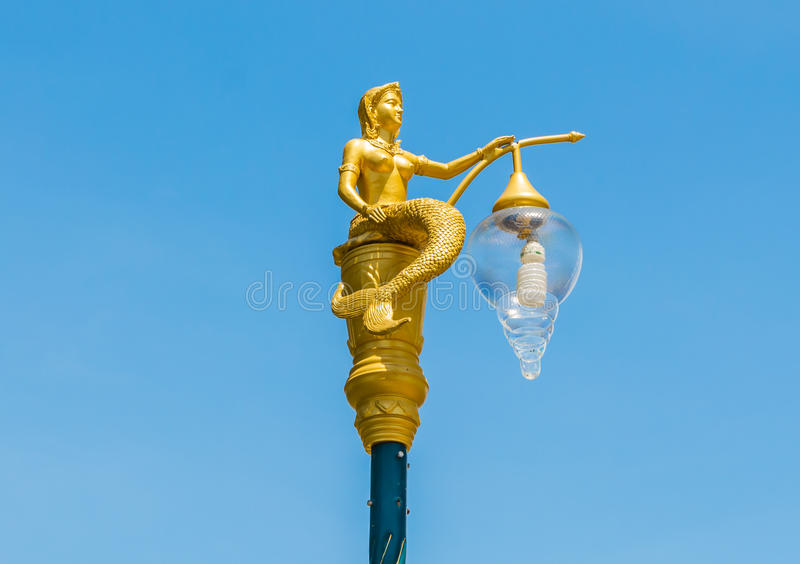 Golden mermaid street lamp. royalty free stock image