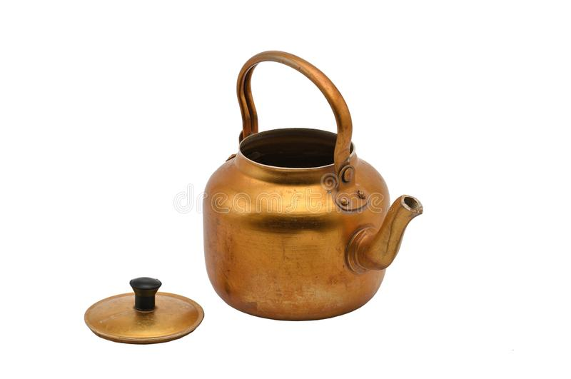 Golden metal kettle on a white background.Teapot stock photo