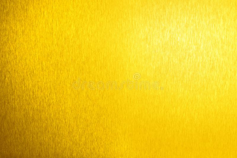 Golden metal shiny empty surface, yellow shining metallic background, gold sheet backdrop close up, decorative sparkling texture. Golden metal shiny empty royalty free stock photo