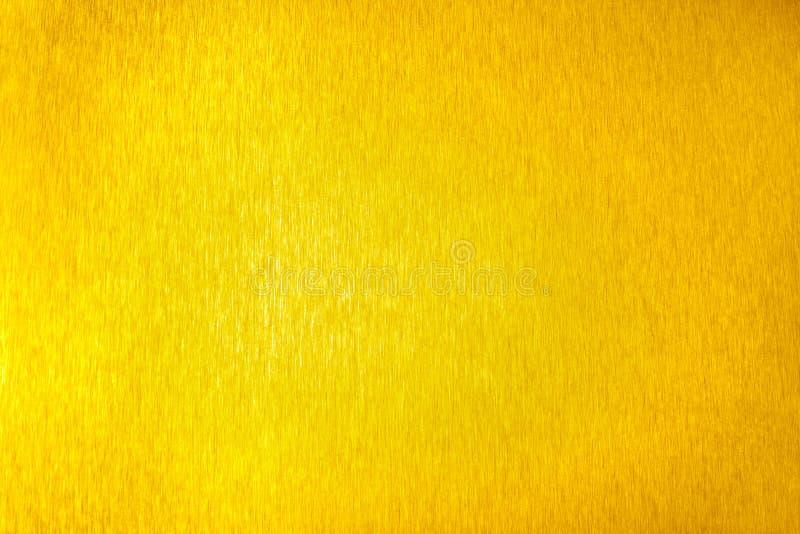 Golden metal shiny empty surface, yellow shining metallic background, gold sheet backdrop close up, decorative sparkling texture. Golden metal shiny empty stock image