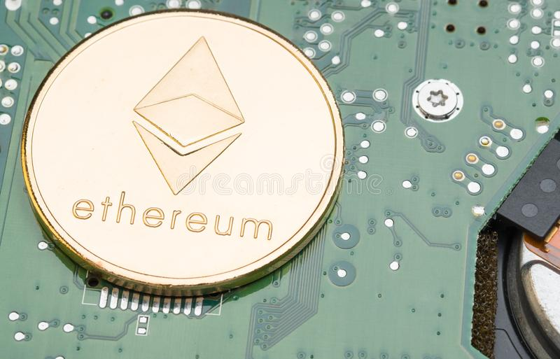 golden metallic ethereum on electronic circuit motherboard.crypto currency mining.Digital money on blockchain network. royalty free stock images