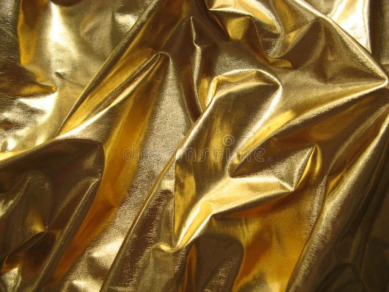 Golden metallic fabric royalty free stock photography