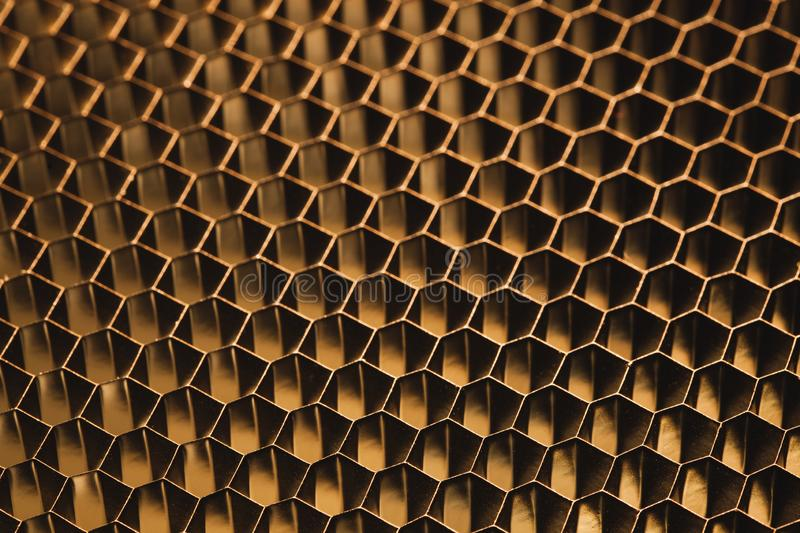 Golden metallic honeycomb grid texture pattern. Background royalty free stock images