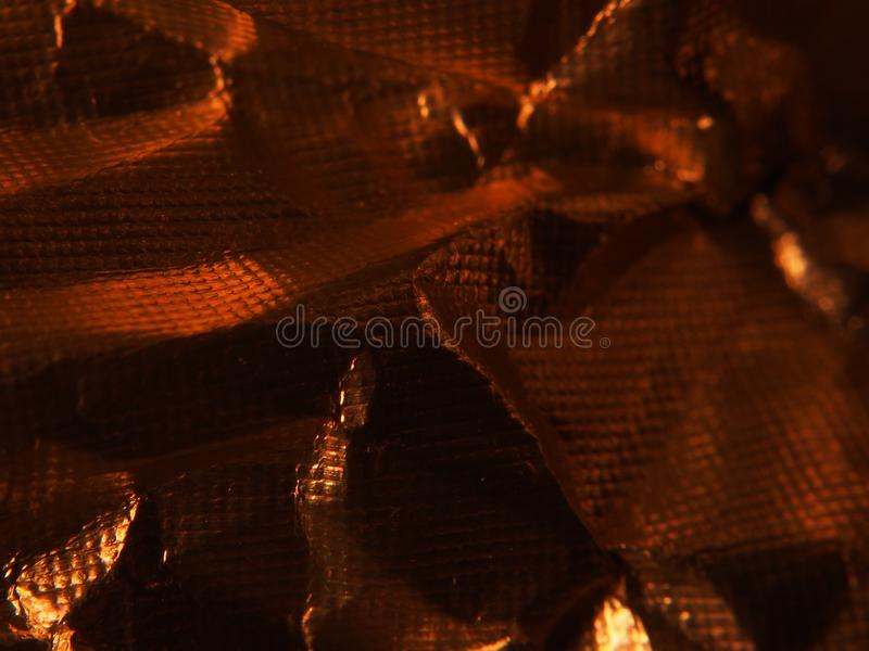 Golden metallic structure. The texture of the foil. Macrophotography antique luxury vibrant wallpaper shiny material design glamour grunge pattern surface royalty free stock images