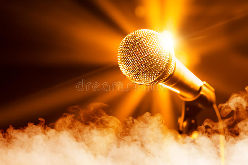 Golden microphone on stage. With smoke royalty free stock photo