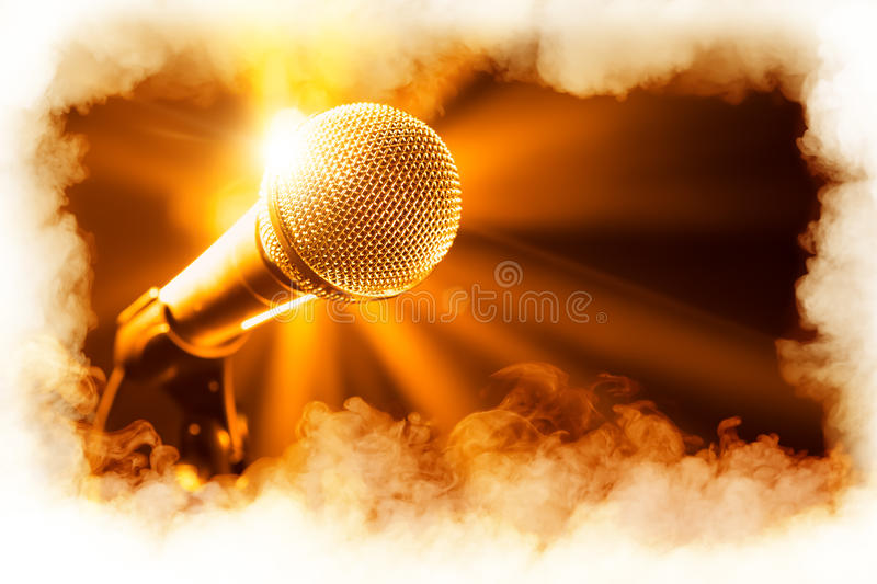 Golden microphone on stage. With smoke frame stock photos