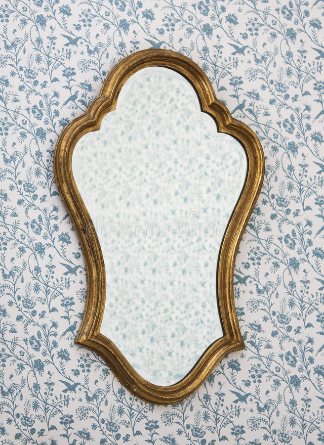 Golden Mirror Frame. On wall with Victorian wallpaper royalty free stock images