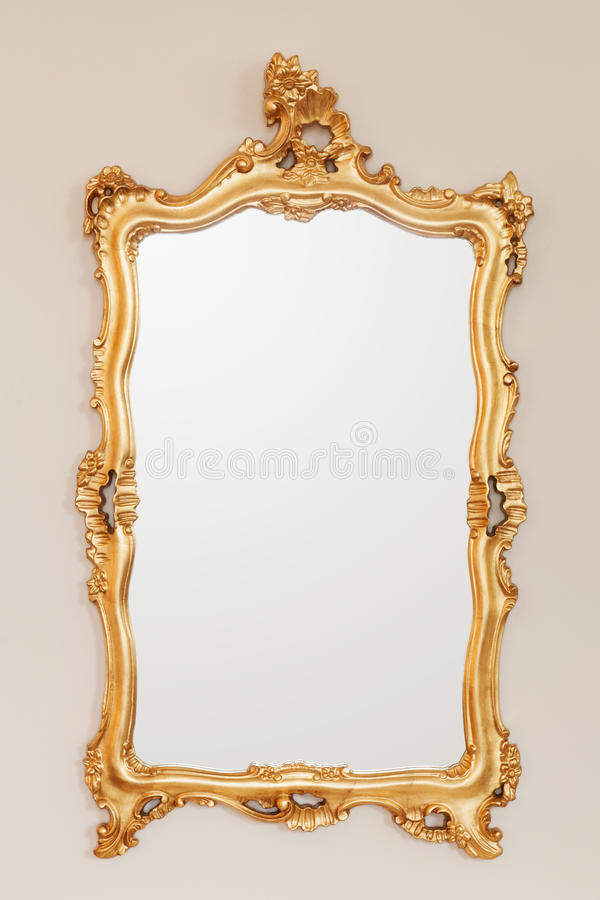 Golden mirror frame. On the wall stock photo