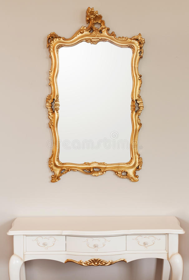 Golden mirror frame royalty free stock images