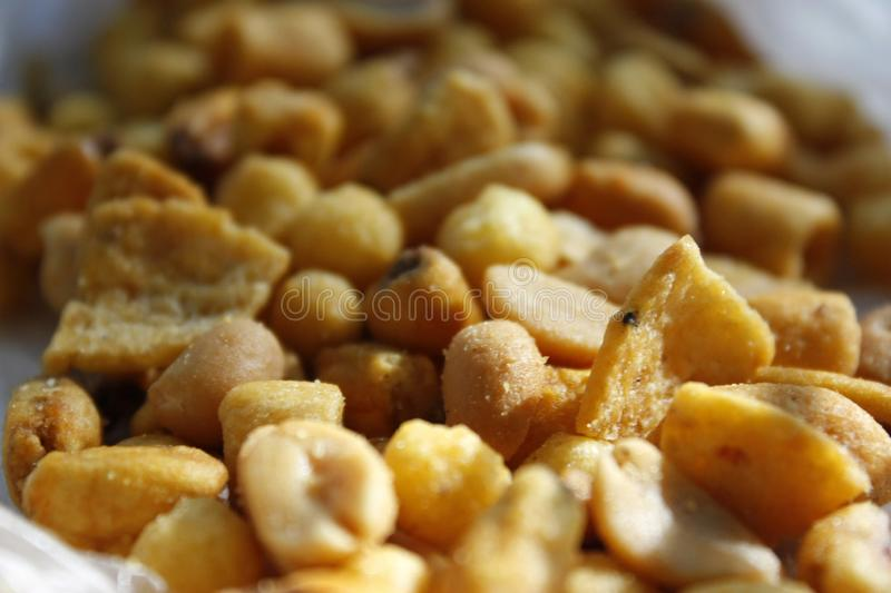 Golden mixed nuts, snacks, chips for beer close-up with selective focus royalty free stock photos