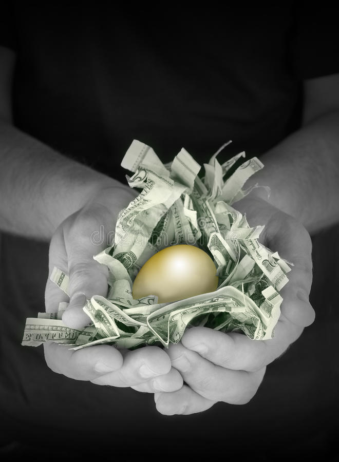 Golden Money Nest Egg Savings stock photography