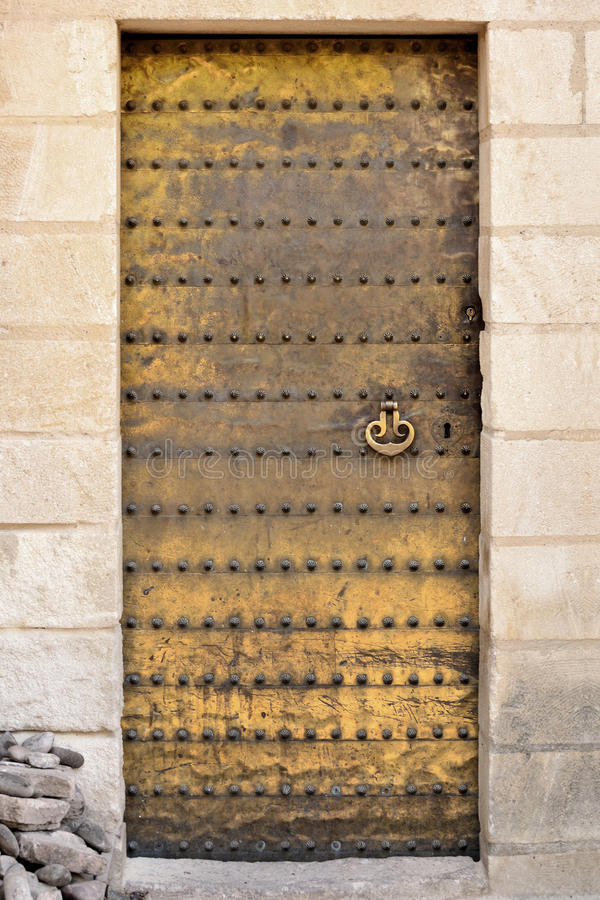 Golden moorish door. Golden moorish door of the Mosque–Cathedral of Cordoba, Spain stock image