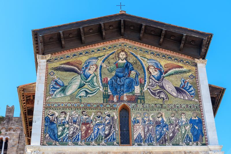 Golden mosaic on facade of Basilica of San Frediano. Lucca. Italy stock images