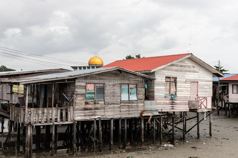 Golden Mosque Dome Above Poor Poverty Village Disrepair Run Down stock photography