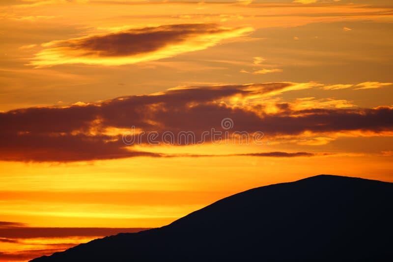 Golden mountain sunrise. Beautiful golden sky mountain sunrise background stock photo