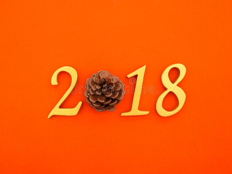 New Year 2018 Banner. A golden new year 2018 banner on bright orange paper background royalty free stock photos