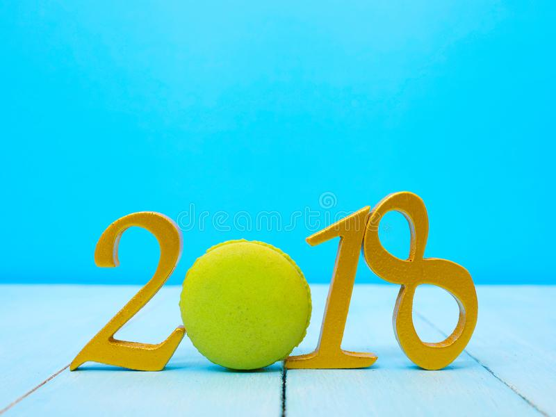 New Year 2018 Banner. A golden new year 2018 banner on pale blue wooden background royalty free stock photography