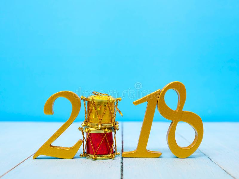 New Year 2018 Banner. A golden new year 2018 banner on pale blue wooden background stock image