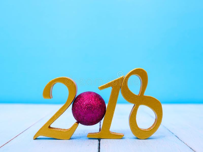 New Year 2018 Banner. A golden new year 2018 banner on pale blue wooden background stock images
